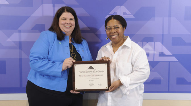Photo of AALL President, Holly Riccio, presenting the 2015 AALL Best Newsletter Award to CALL Bulletin Co-Editor, Lyonette Louis-Jacques.